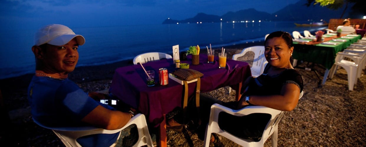 Timor-Leste: Human, People, Person, Chair, Furniture, Table, Restaurant, Cafe, Alcohol, Beverage, Drink, Dining Table, Soil, Dining Room, Indoors, Interior Design, Room, Outdoors, Face, Portrait, Home Decor, Linen, Tablecloth, Female, Landscape, Nature, Scenery, Pub