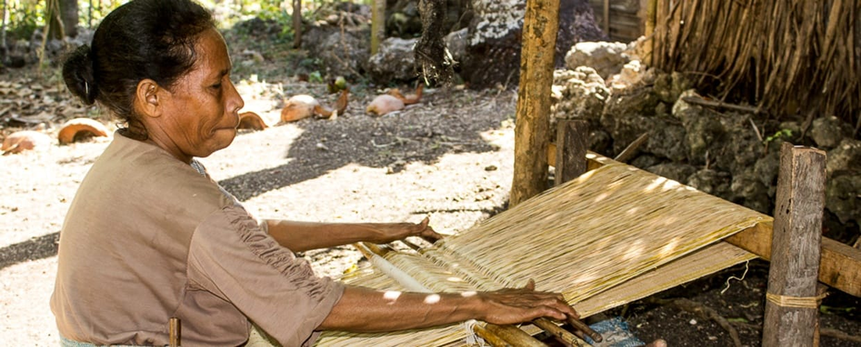 Timor-Leste: Human, People, Person, Woven, Carpenter, Flora, Para Rubber Tree, Plant, Tree, Bench, Lumber, Wood, Ground, Soil, Outdoors, Wilderness, Forest, Land, Nature, Vegetation