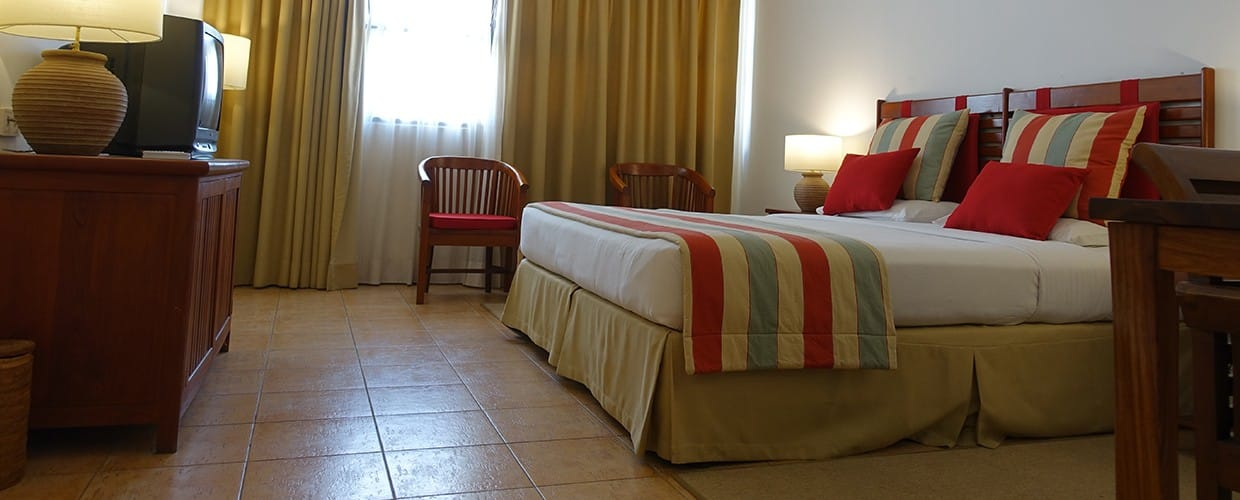 Timor-Leste: Bed, Furniture, Flooring, Indoors, Room, Apartment, Building, Housing, Chair, Home Decor, Quilt, Cushion, Bedroom, Interior Design, Dining Room