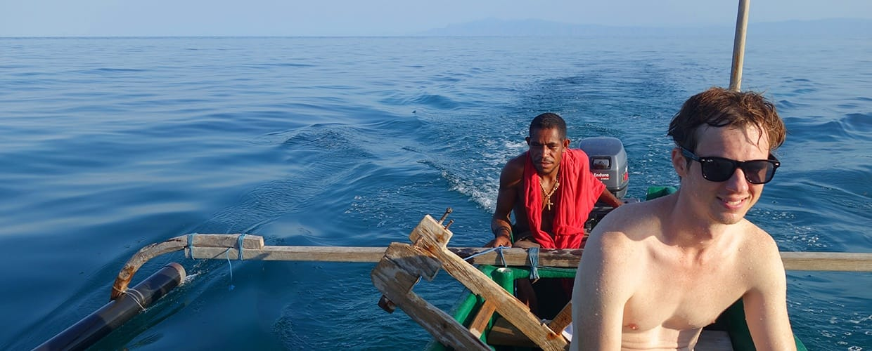 Timor-Leste: Human, People, Person, Boat, Transportation, Vessel, Watercraft, Leisure Activities, Dinghy, Animal, Cod, Fish, Nature, Ocean, Outdoors, Sea, Water, Dock, Pier, Ship