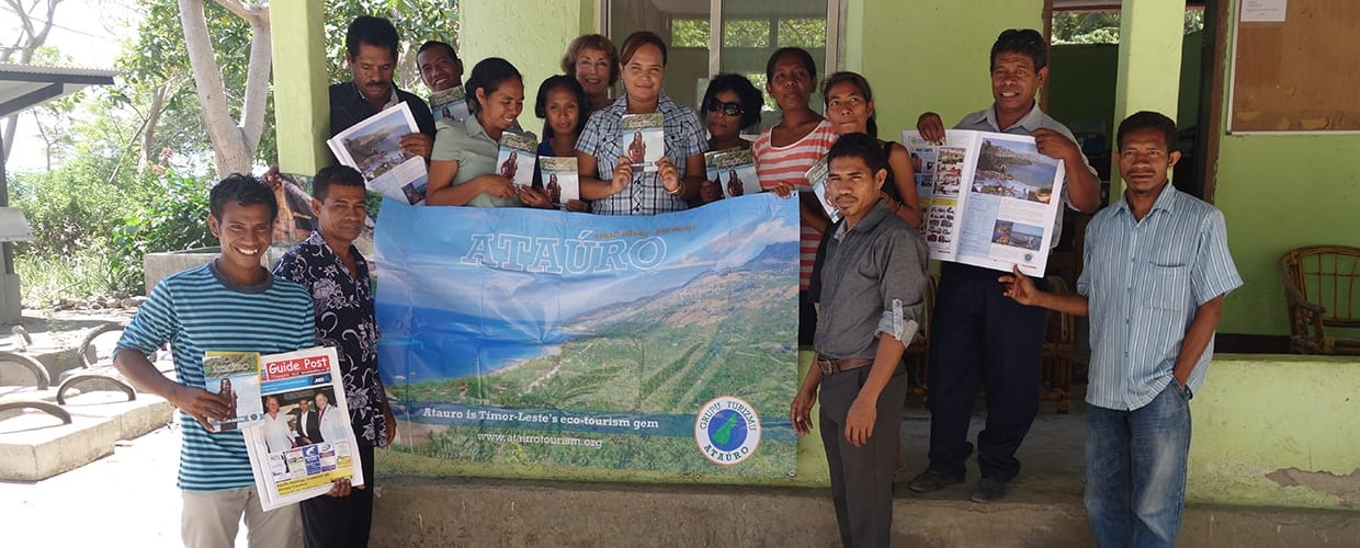 Timor-Leste: Human, People, Person, Reading, Team, Apparel, Clothing
