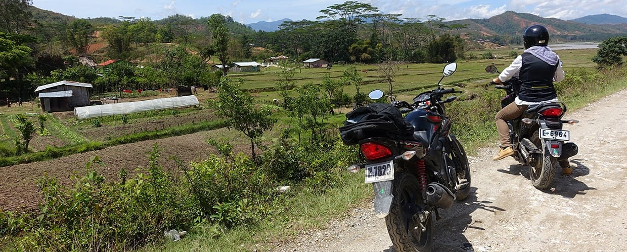 Timor-Leste: Human, People, Person, Motorcycle, Transportation, Vehicle, Bicycle, Bike, Moped, Motor Scooter, Vespa, Dirt Road, Gravel, Road, Scooter, Adventure, Leisure Activities