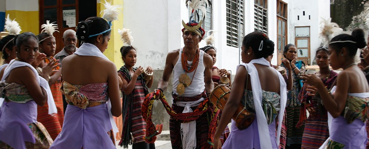 Timor-Leste: Human, People, Person, Back, Afro Hairstyle, Hair, Crowd, Parade, Female, Performer