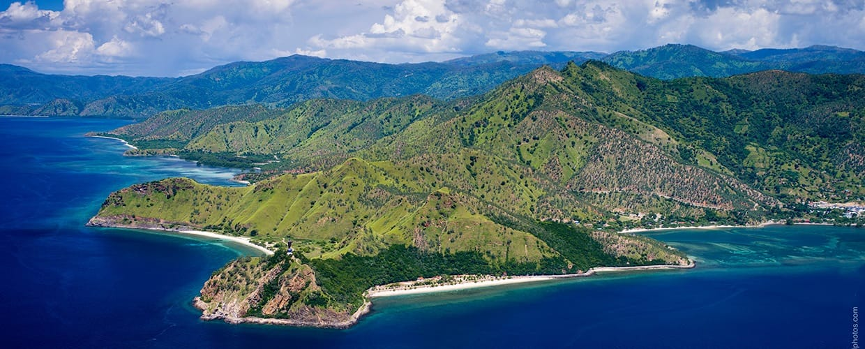 Timor-Leste: Aerial View, Landscape, Nature, Outdoors, Scenery, Coast, Island, Land, Ocean, Sea, Water, Bay, Peninsula, Beach, Promontory, Harbor, Port, Waterfront, Building, City, Town, Urban
