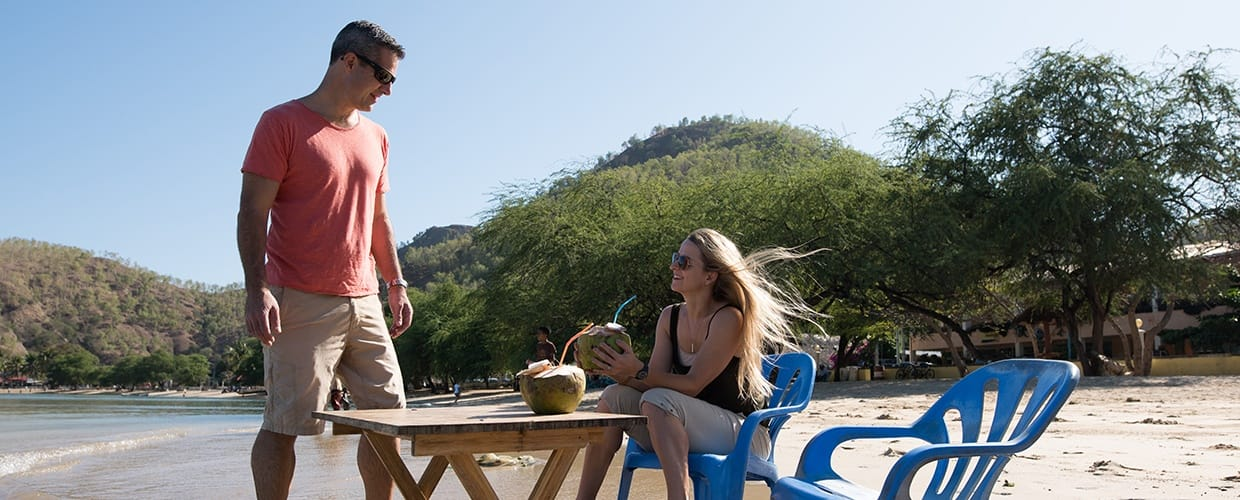 Timor-Leste: Human, People, Person, Shorts, Barefoot, Chair, Furniture, Leisure Activities, Eating, Food, Meal
