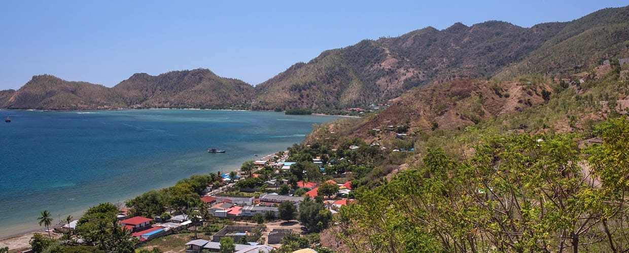 Timor-Leste: Promontory, Building, City, Town, Urban, Cliff, Outdoors, Coast, Nature, Ocean, Sea, Water, Beach, Countryside