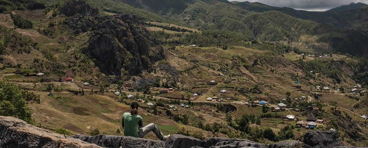 Timor-Leste: Crest, Mountain, Mountain Range, Nature, Outdoors, Architecture, Building, Housing, Monastery, Sitting, Wilderness, Valley, Aerial View, Landscape, Scenery, City, Town, Urban, Ruins, Soil, Land, Rock