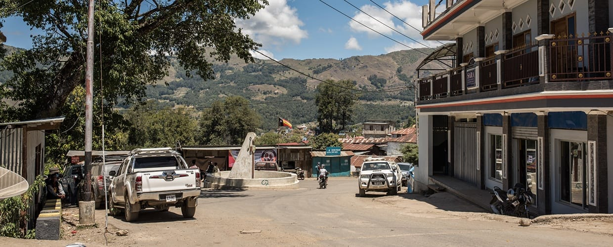Timor-Leste: Automobile, Car, Suv, Transportation, Vehicle, Building, Neighborhood, Urban, City, Town, House, Housing, Villa, Offroad, Jeep, Landscape, Nature, Outdoors, Scenery, Alley, Alleyway, Road, Street, Apartment Building, High Rise, Intersection, Van, Sedan