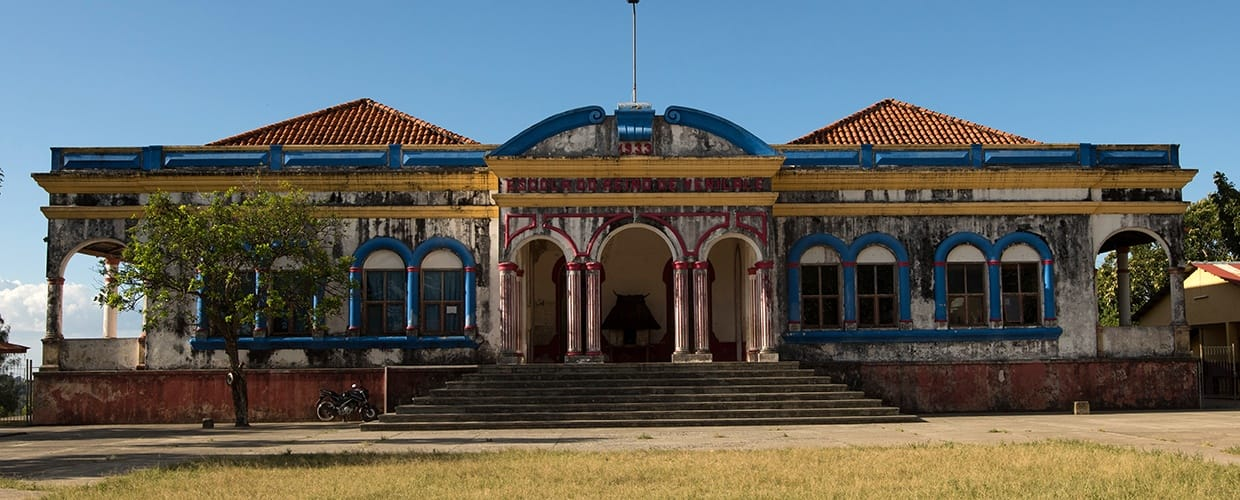 Timor-Leste: Flora, Jar, Plant, Potted Plant, Pottery, Vase, Balcony, Building, House, Housing, Villa, Brick, Architecture, Court, Tree, Arch, Arched, Monastery, Castle, Mansion, Palace, Conifer, Yew, City, Town, Urban, Oak, Sycamore, Church, Worship