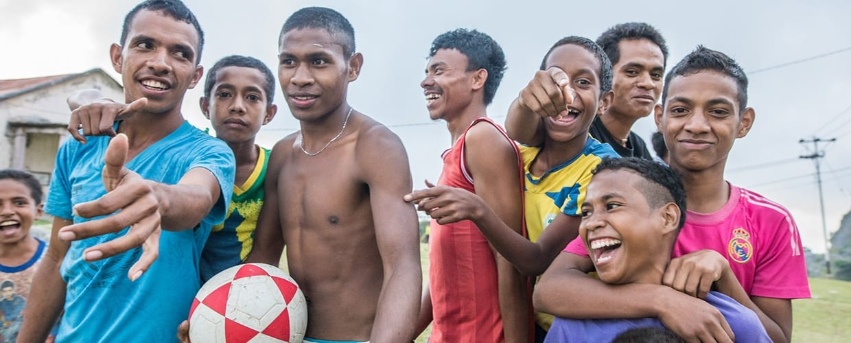 Timor-Leste: Human, People, Person, Doctor, Surgeon, Face, Portrait, Smile, Crowd, Bikini, Clothing, Swimwear, Female, Leisure Activities, Torso, Laughing, Football, Sport, Sports, Team, Team Sport