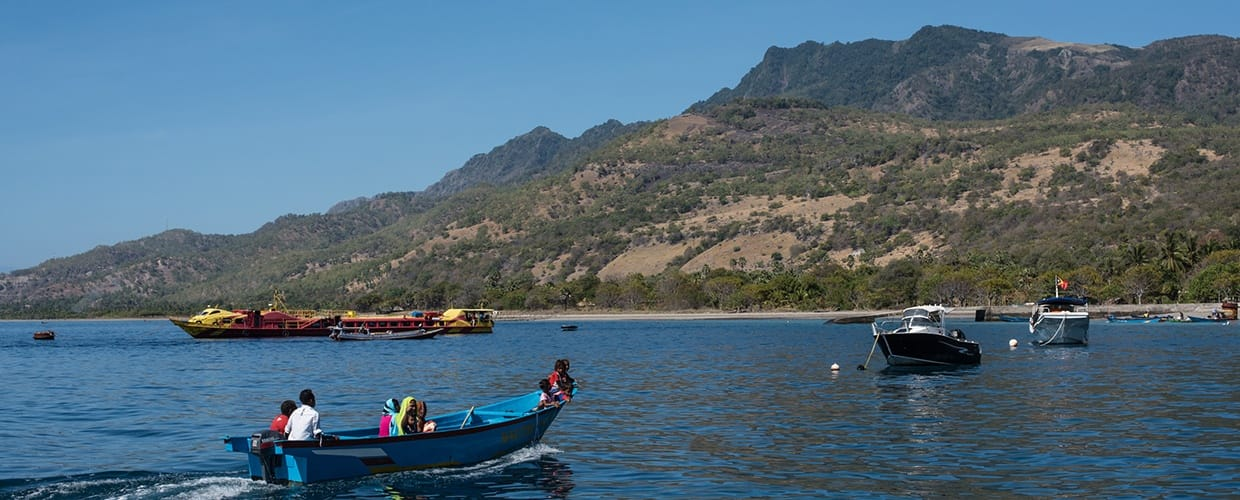 Timor-Leste: Boat, Canoe, Rowboat, Transportation, Vessel, Watercraft, Lake, Outdoors, Water, Dinghy, Promontory, Harbor, Port, Waterfront, Leisure Activities