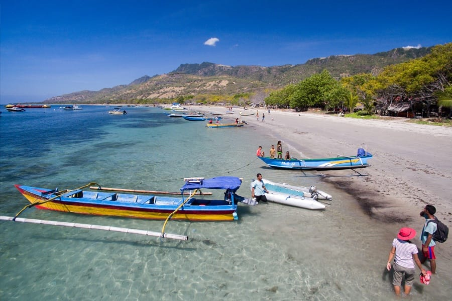 Timor-Leste: Human, People, Person, Beach, Coast, Nature, Ocean, Outdoors, Sea, Water, Boat, Rowboat, Transportation, Vessel, Watercraft, Promontory, Yacht, Island, Land, Canoe, Outrigger, Leisure Activities, Baby, Child, Kid, Dock, Pier, Dinghy, Ferry, Banana Boat, Sand, Soil, Building, Hotel, Resort