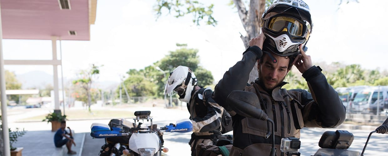 Timor-Leste: Human, People, Person, Motorcycle, Sidecar, Transportation, Vehicle, Animal, Equestrian, Horse, Mammal, Moped, Motor Scooter, Vespa, Scooter, Outdoors, Clothing, Coat, Jacket