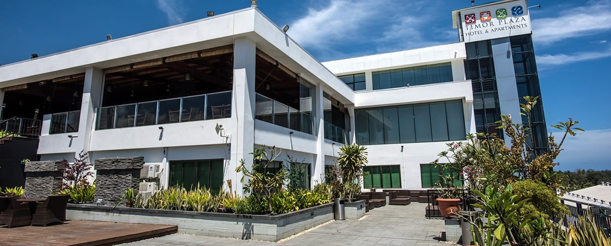 Timor-Leste: Flora, Jar, Plant, Potted Plant, Pottery, Vase, Building, Housing, Office Building, House, Villa, Hotel, Inn, City, High Rise, Town, Urban, Apartment Building, Balcony, Architecture, Convention Center, Neighborhood, Downtown