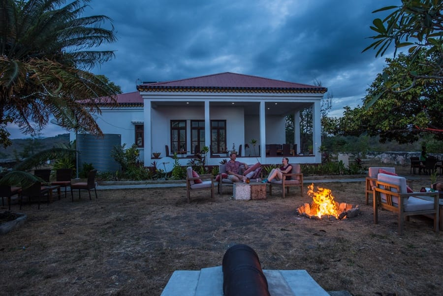 Timor-Leste: Bench, Building, House, Housing, Villa, Arecaceae, Flora, Palm Tree, Plant, Tree, Chair, Furniture, Cottage, Forest, Jungle, Land, Nature, Outdoors, Vegetation, Backyard, Yard, Fire, Flame, Hotel, Resort, Tropical, Conifer, Pine, Rainforest, Mansion, Leisure Activities, Yew, Abies, Fir, Neighborhood, Urban